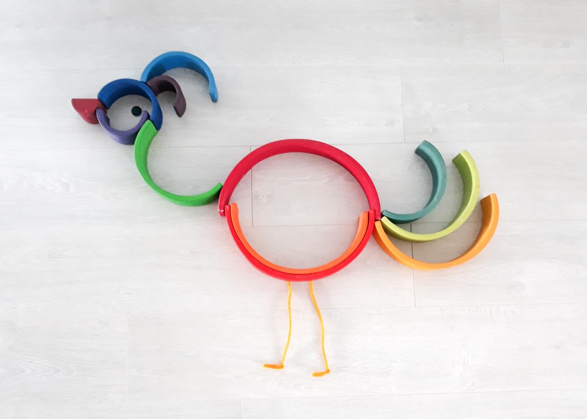 houten regenboog voorbeeld struisvogel