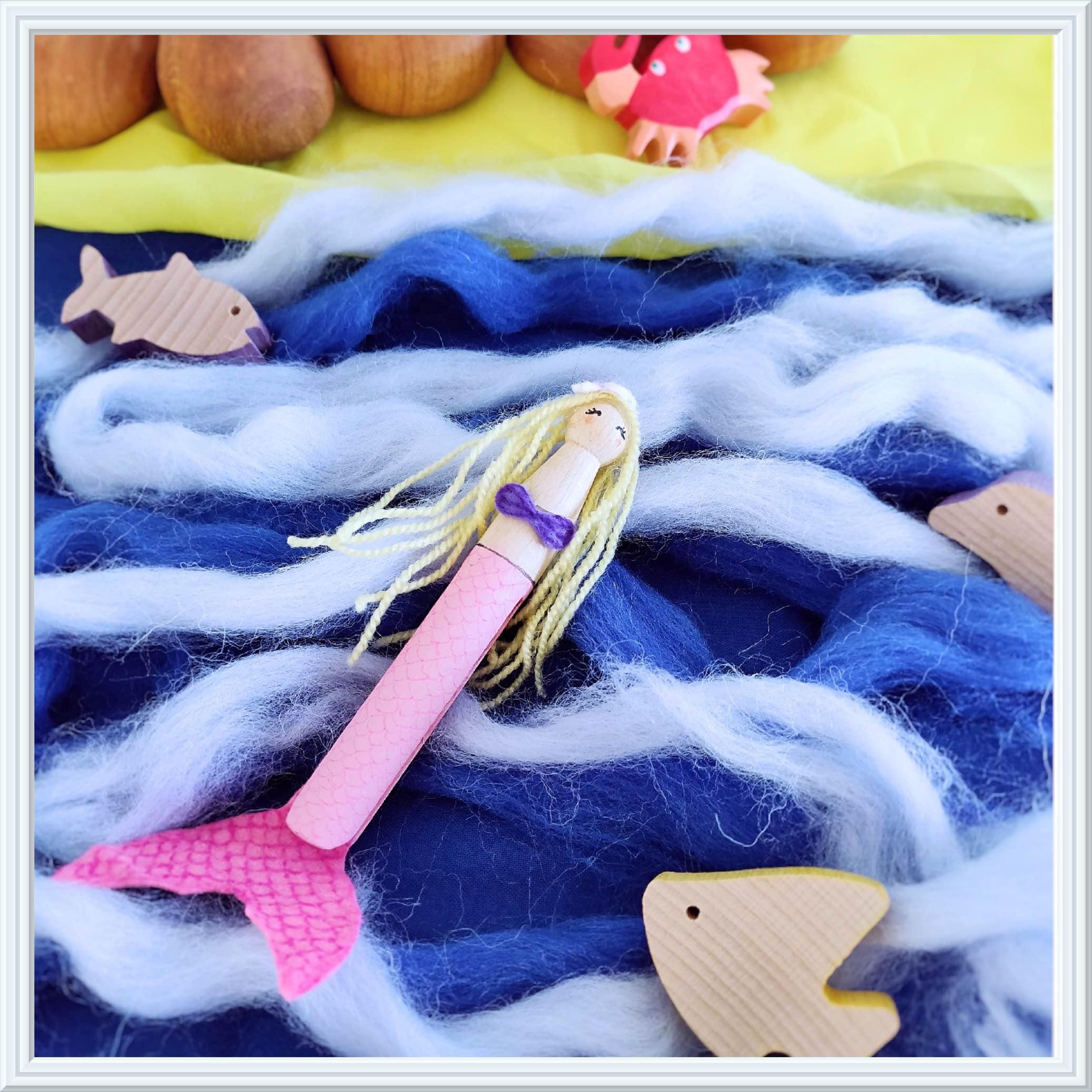 sprookjes met houten speelgoed, kleine zeemeermin